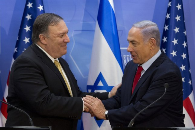 Secretary of State Mike Pompeo (L) shakes hands with Israeli Prime Minister Benjamin Netanyahu during their meeting at the Prime Minister's office in Jerusalem on Wednesday. Pool Photo by Sebastian Scheiner/UPI