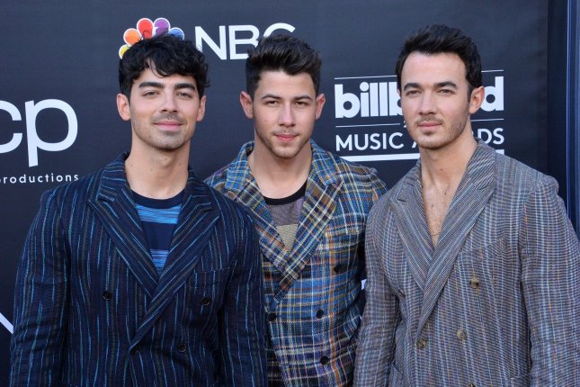 The Jonas Brothers, left to right, Joe, Nick and Kevin, are set to appear on Nickelodeon's new version of All That. Photo by Jim Ruymen/UPI