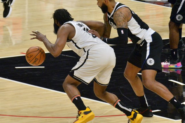 Brooklyn Nets guard James Harden (L) played only four minutes before being ruled out of Monday's win over the New York Knicks. File Photo by Jim Ruymen/UPI