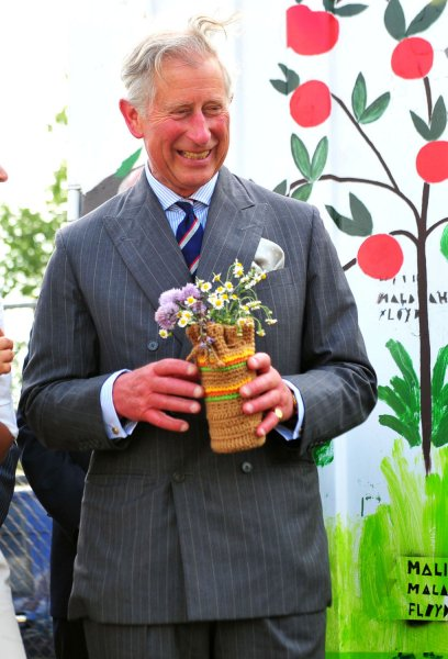 Britain's Prince Charles walks with a bouquet of flowers as he visits Common Good City Farm in Washington, D.C. on May 3, 2011. UPI/Kevin Dietsch