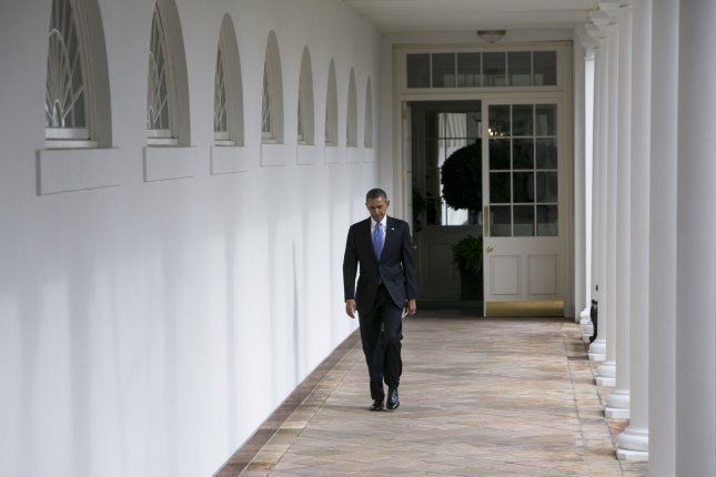 U.S. President Barack Obama walks along the colonnade of the White House from the residence to the Oval Office a few hours before he is to deliver the State Of The Union speech before congress on January 28, 2014 in Washington, DC. UPI/Kristoffer Tripplaar/Pool