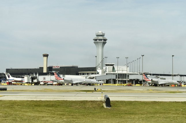 Raytheon tapped to upgrade air traffic control systems at 22 more U.S. airports. Pictured, the main control tower rises above the terminals in the center of O'Hare International Airport in Chicago. File photo by Brian Kersey/UPI