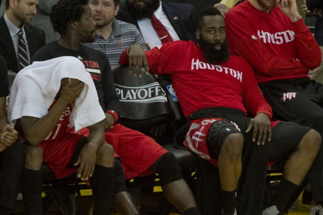 Houston Rockets James Harden (2nd from right) posted his second consecutive triple-double as the Houston Rockets turned another record-setting performance into a 122-100 win over the New Orleans Pelicans on Friday night at Toyota Center. File Photo by Terry Schmitt/UPI