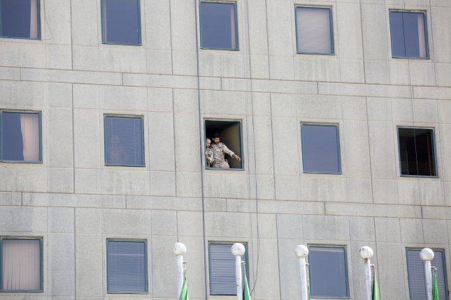 Iranian soldiers stand in a window of the parliament building in Tehran, Iran on Wednesday after suicide bombers and gunmen attacked Iran's parliament and the Mausoleum of Ayatollah Khomeini. Photo by Maryam Rahmanian/UPI