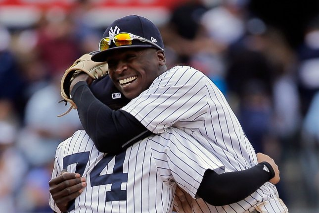 New York Yankees shortstop Didi Gregorius hugs shortstop Ronald Torreyes (74) after they beat the Boston Red Sox in their American League MLB game at Yankee Stadium in New York City, September 2, 2017. File photo by Ray Stubblebine/UPI