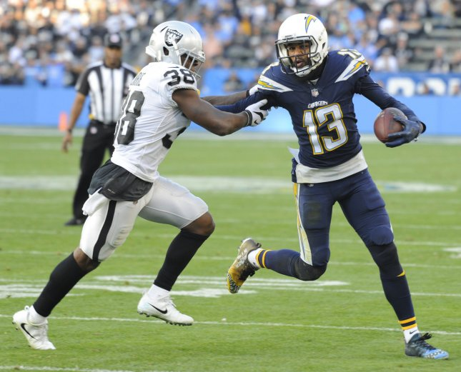 Oakland Raiders defensive back TJ Carrie tries to tackle Los Angeles Chargers receiver Keenan Allen during their game in December. Photo by Lori Shepler/UPI