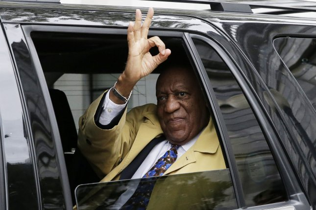 Bill Cosby gives the OK sign as his car pulls away from a courthouse in Norristown, Penn., after closing arguments in his sexual assault trial on April 24, 2018. Cosby was found guilty but the Pennsylvania Supreme Court agreed Tuesday to hear an appeal. File photo by John Angelillo/UPI