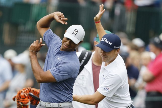 Tiger Woods (L) provided advice for Justin Thomas (R) recently on how to play the Ocean Course at the 2021 PGA Championship this week in Kiawah Island, S.C. File Photo by John Angelillo/UPI