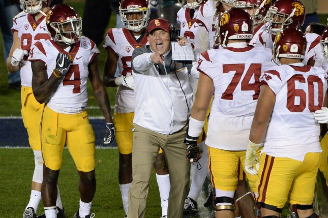 USC Trojans head coach Clay Helton (C), shown Jan. 2, 2017, was fired just two days after his team suffered a blowout loss to Stanford. File Photo by Jon SooHoo/UPI