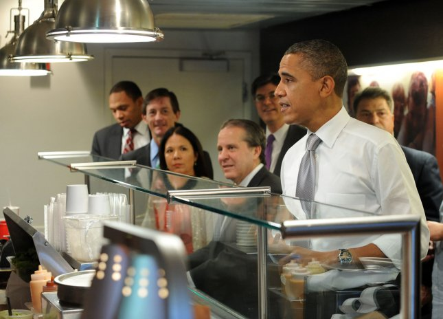 U.S. President Barack Obama orders a burger from Good Stuff Eatery in the Capitol Hill neighborhood of Washington, DC, on August 3, 2011. UPI/Roger L. Wollenberg