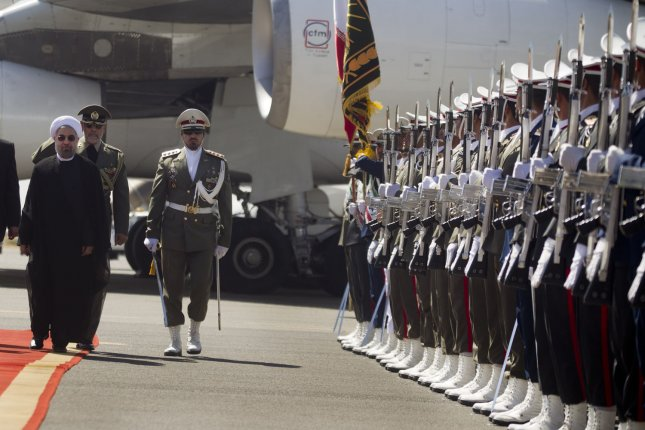 Iranian President Hassan Rouhani reviews an honor guard upon his arrival to the Mehrabad Airport in Tehran, Iran on September 28, 2013. On Friday, September 27, 2013, before Rouhani's departure from New York, the Iranian president and American President Barack Obama held a telephone conversation. The call was the first direct communication between an Iranian and a US president since Iran's Islamic Revolution in 1979. UPI/Maryam Rahmanian