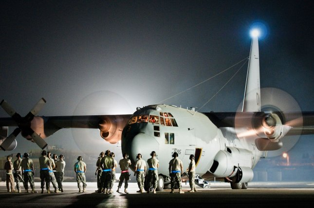 Maintenance troops and aircrew members prepate a U.S. Air Force EC-130H aircraft for its final departure from an undisclosed air base in Southwest Asia on August 29, 2010. UPI/Dale Greer/U.S. Air Force