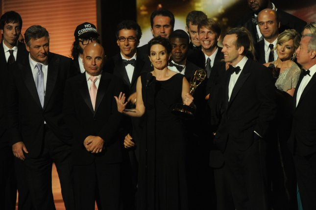 Tina Fey accepts the trophy for 30 Rock at the 61st Primetime Emmy Awards at the Nokia Center in Los Angeles on September 20, 2009. UPI /Jim Ruymen