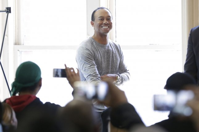 Tiger Woods arrives to sign copies of his new book, The 1997 Masters: My Story, at the Union Square Barnes & Noble in New York City on March 20, 2017. The book is a reflection on his historic Masters win in honor of its upcoming twentieth anniversary. Photo by John Angelillo/UPI