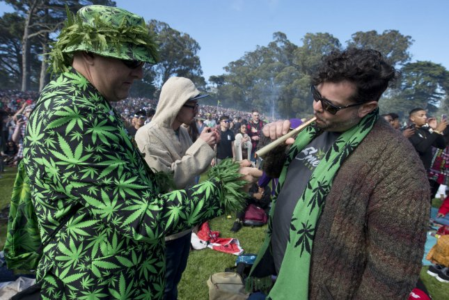Marijuana smokers light up at 4:20 at the annual 420 marijuana party at Hippie Hill in Golden Gate Park in San Francisco on April 20. Photo by Terry Schmitt/UPI
