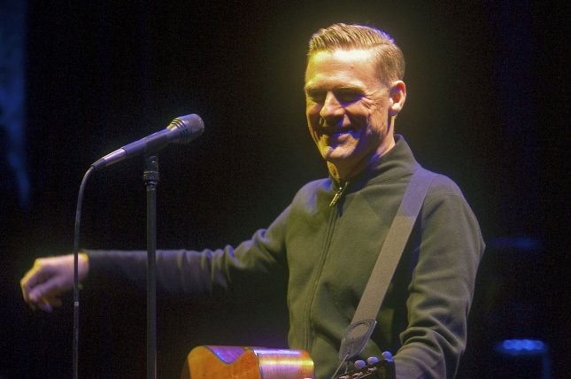 Bryan Adams sings onstage during Sarah McLachlan's Voices in the Park benefit concert in Stanley Park, Vancouver, British Columbia, on September 15, 2012. The musician turns 60 on November 5. File Photo by Heinz Ruckemann/UPI