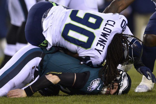 Philadelphia Eagles quarterback Carson Wentz (bottom) sustained a concussion after being hit by Seattle Seahawks defender Jadeveon Clowney during a playoff game Jan. 5 at Lincoln Financial Field in Philadelphia. Photo by Derik Hamilton/UPI