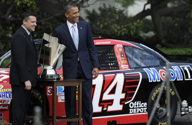U.S. President Barack Obama ((R) poses with NASCAR Sprint Car Series Champion Tony Stewart with his trophy and in front of his Number *14* Chevrolet, on the South Lawn of the White House in Washington, April 17, 2012. UPI/Mike Theiler