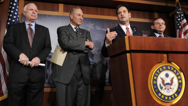 Sen. Marco Rubio (R-FL) speaks from the podium as (L-R) Sen. John McCain (R-AZ), Sen. Charles Schumer (D-NY) and Sen. Robert Menendez ((D-NJ) listen to his remarks on a bi-partison plan to introduce immigration reform, at the US Capitol, January 28, 2013, in Washington, DC. The legislation follows the so-called *Dream Act*, a comprehensive path to citizenship for millions of illegal aliens in the US. UPI/Mike Theiler