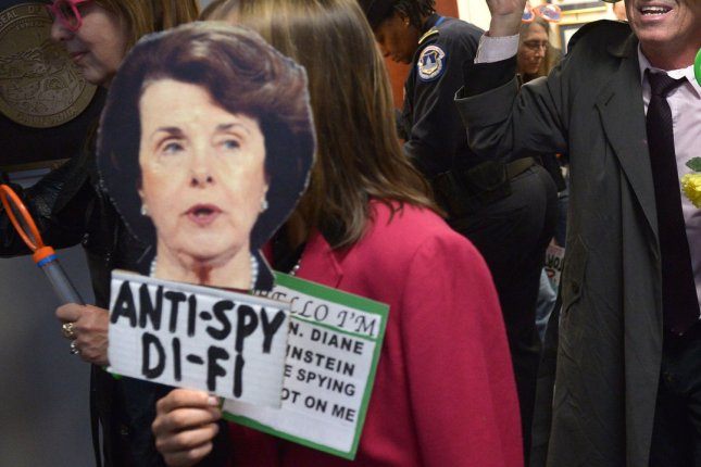 Members of the CodePink activist group demonstration against Sen. Dianne Feinstein (D-CA) and what the group is calling her 'two-faced stance on spying' inside her office in the Hart Senate Office Building in Washington, DC, on March 12, 2014. Senator Feinstein called for federal regulation of drones on 60 minutes last night, citing concerns about privacy. UPI/Kevin Dietsch