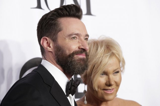 Deborra-Lee Furness (R) and husband Hugh Jackman at the Tony Awards on June 8, 2014. The actress jokingly banned her husband from working with Angelina Jolie in a new interview. File photo by John Angelillo/UPI