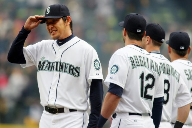 Seattle Mariners' pitcher Iwakuma Hisashi, of Japan, touches his hat after being introduced before playing the Los Angeles Angels in the season home opener April 6, 2015 at Safeco Field in Seattle. The Mariners beat the Angels 4-1. Photo by Jim Bryant/UPI