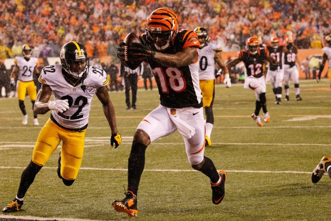 Cincinnati Bengals wide receiver A.J. Green (18) runs in for the touchdown under pressure from Pittsburgh Steelers' William Gay (22) during the second half of play in their NFL Wild Card Round game at Paul Brown Stadium in Cincinnati, Ohio, January 9, 2016. Photo by John Sommers II/UPI