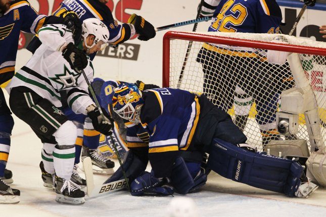 St. Louis Blues goaltender Brian Elliott gets his glove on the puck to stop the progress of Dallas Stars' Cody Eakin in the first period of Game Six of the NHL Playoffs at the Scottrade Center in St. Louis on May 9, 2016. File photo by Bill Greenblatt/UPI