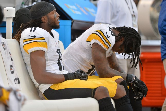 Former Pittsburgh Steelers wide receiver Markus Wheaton (11) and ex-Steelers wide receiver Martavis Bryant (10) sit on the bench against the Baltimore Ravens on December 27, 2015 at M&T Bank Stadium in Baltimore. File photo by Kevin Dietsch/UPI