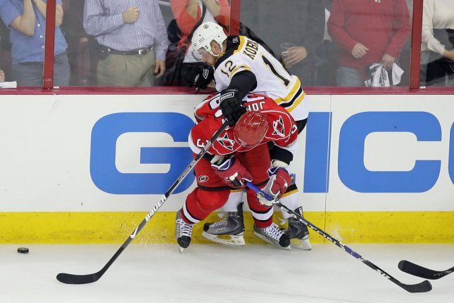 Boston Bruins Chuck Kobasew (12) battles for the puck against Carolina Hurricanes Jussi Jokinen (bottom) during the third period of Game 6 of an NHL Eastern Conference Semi-finals Hockey game in Raleigh, North Carolina, May 12, 2009. The Bruins beat the Hurricanes 4-2. (UPI Photo/Jeff Basladynski)