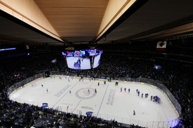 The New York Rangers team come out on to the ice to celebrate after the game against the Tampa Bay Lightning in game 1 in the third round of the Stanley Cup Playoffs at Madison Square Garden in New York City on May 16, 2015. The Rangers defeated the Lightning 2-1 and lead the best of seven series 1-0. Photo by John Angelillo/UPI