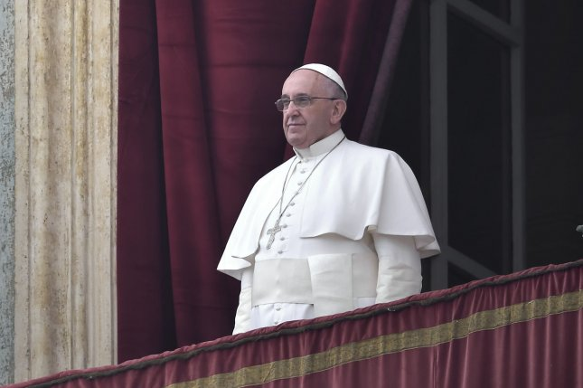 Pope Francis delivers the Urbi et Orbi (to the city and to the world) Christmas Day message from the central balcony of St. Peter's Basilica in Vatican City on December 25, 2014. On Sunday, January 4, 2015, the Pope announced 20 bishops to be made cardinals in the Catholic Church, all coming from over a dozen different countries. UPI/Stefano Spaziari
