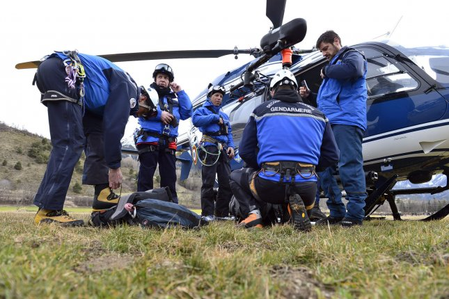 Handout pictures dated 25 March 2015 members of the French national gendarmerie investigating the area after the A320 Lufthansa passenger aircraft crashed in a mountain range of the French Alps. The plane heading to Dusseldorf from Barcelona with 150 people onboard was allegedly taken down by its co-pilot Andreas Lubitz, there were no survivors. Photo by Francis Pellier/MI DICOM/UPI