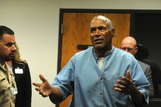 O.J. Simpson reacts after learning he was granted parole at Lovelock Correctional Center on July 20 in Lovelock, Nevada. Pool photo by Jason Bean/UPI