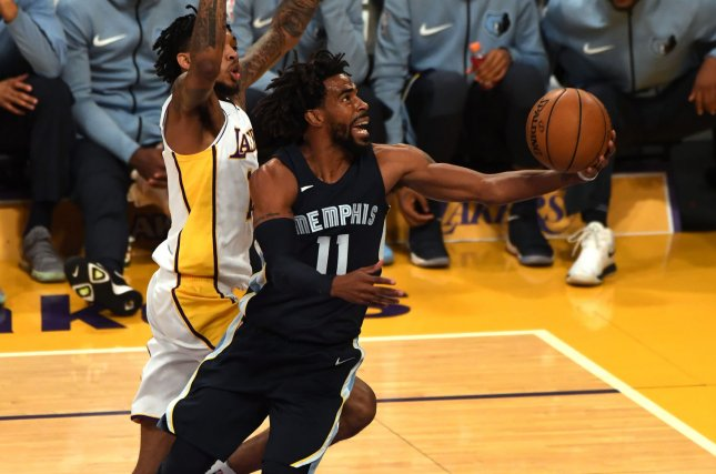 Memphis Grizzlies guard Mike Conley (11) attempts a layup during first-quarter action on November 5, 2017 at Staples Center in Los Angeles. File photo by Jon SooHoo/UPI