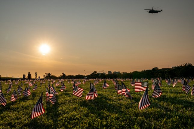 The COVID Memorial Project near the Washington Monument in Washington, DC has flags to represent the over 200,000 people who have now died of COVID-19. File Photo by Ken Cedeno/UPI.