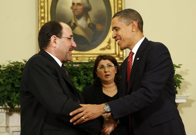 U.S. President Barack Obama (R) and Iraqi Prime Minister Nouri al-Maliki meet in the Oval Office of the White House in Washington on October 20, 2009. UPI/Aude Guerrucci/Pool