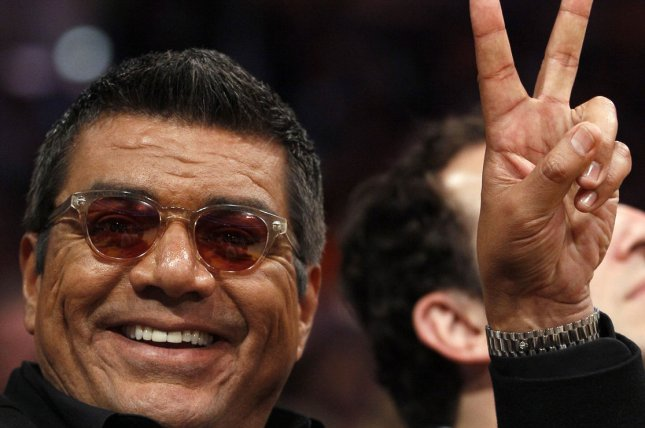 George Lopez gives the peace sign during Game 2 of the Los Angeles Lakers and New Orleans Hornets in their Western Conference Playoff series at Staples Center in Los Angeles on April 20, 2011. The Lakers defeated the Hornets . UPI Photo/Lori Shepler