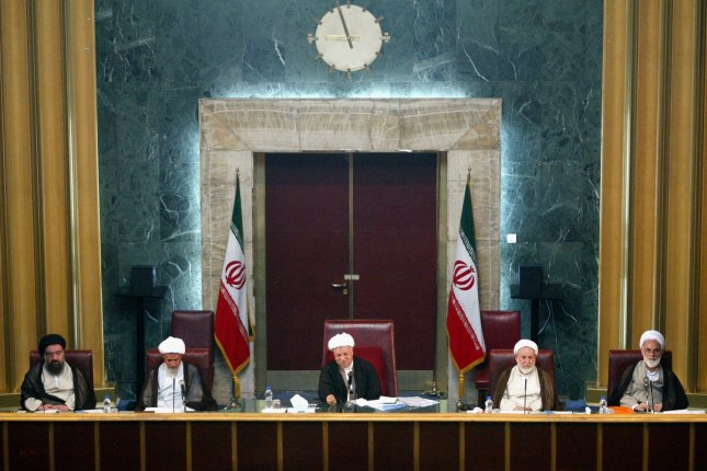 Mohammad Yazdi, second from right, sits with Iran's former President Ali Akbar Hashemi Rafsanjani, center, and other top Iranian clergymen. The Assembly of Experts is a clerical body that elects the supreme leader. File Photo by Mohammad Kheirkhah/UPI