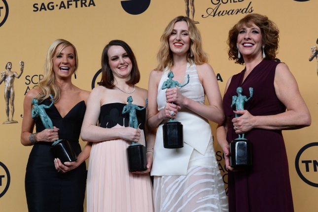 (L-R) Joanne Froggatt, Sophie McShera, Laura Carmichael and Phyllis Logan pose backstage with the award for outstanding performance by a ensemble in a drama series for Downton Abbey at the 21st annual SAG Awards held at the Shrine Auditorium in Los Angeles on January 25, 2015. Photo by Jim Ruymen/UPI
