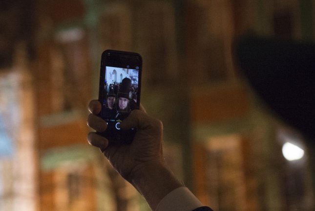 A man dressed as Abraham Lincoln snaps a (non-fatal) selfie. Reports indicate the number of selfie-related deaths in 2015 exceeds the number of fatalities from shark attacks. File Photo by Molly Riley/UPI