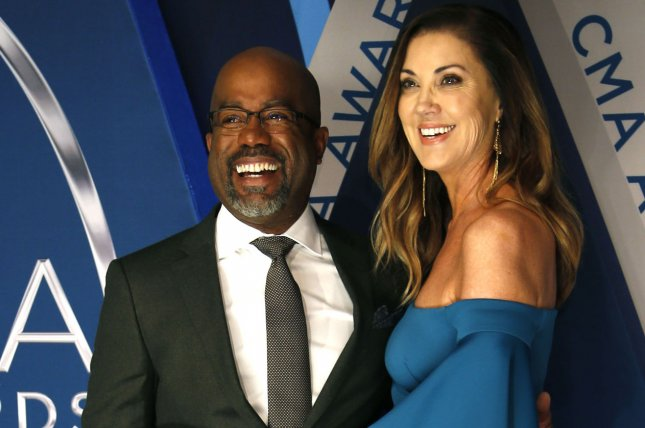 Hootie & the Blowfish singer Darius Rucker (L) and his wife and Beth Leonard. Hootie & the Blowfish have announced a new tour. File Photo by John Sommers II/UPI