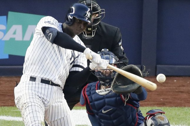New York Yankees shortstop Didi Gregorius hits a grand slam home run in the third inning in Game 2 of the American League Division Series on Saturday against the Minnesota Twins at Yankee Stadium in the Bronx. Photo by John Angelillo/UPI