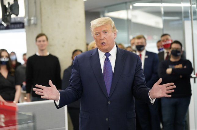 President Donald Trump visits campaign workers at the Republican National Committee Annex in Arlington, Va., on Tuesday. Photo by Chris Kleponis/UPI