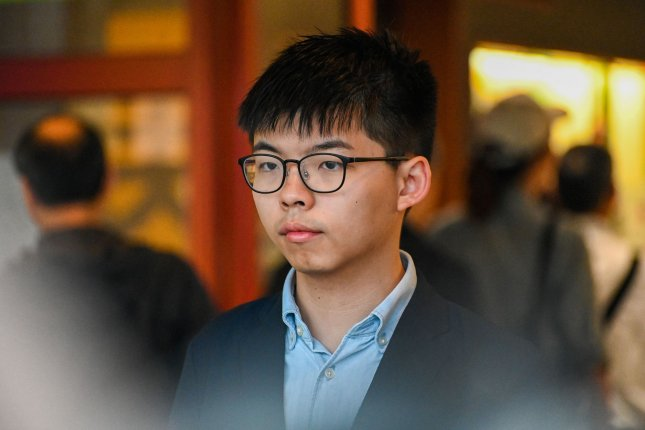 Pro-democracy activist Joshua Wong, pictured here after voting last year in Hong Kong's district council elections, vowed to keep fighting after Wednesday's sentencing. File Photo by Thomas Maresca/UPI