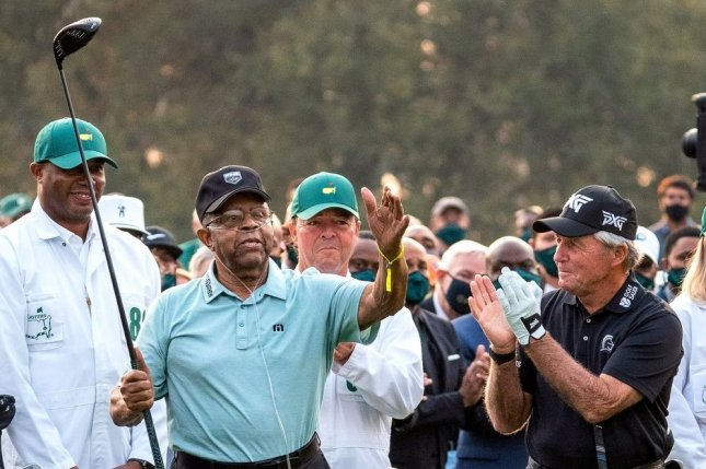Lee Elder, the first Black man to play in the Masters, is honored as Gary Player (C) and Jack Nicklaus (R) applaud, before hitting honorary tee shots Thursday at Augusta National Golf Club in Augusta, Ga. Photo by Kevin Dietsch/UPI
