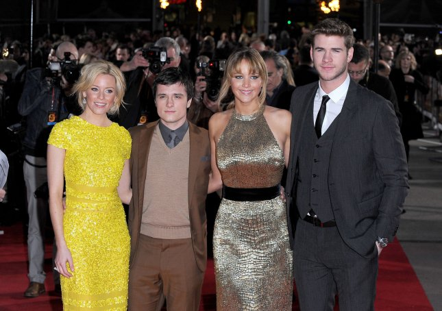 Elizabeth Banks, Josh Hutcherson, Jennifer Lawrence and Liam Hemsworth attend the European premiere of The Hunger Games at O2 Arena in London on March 14, 2012. UPI/Paul Treadway