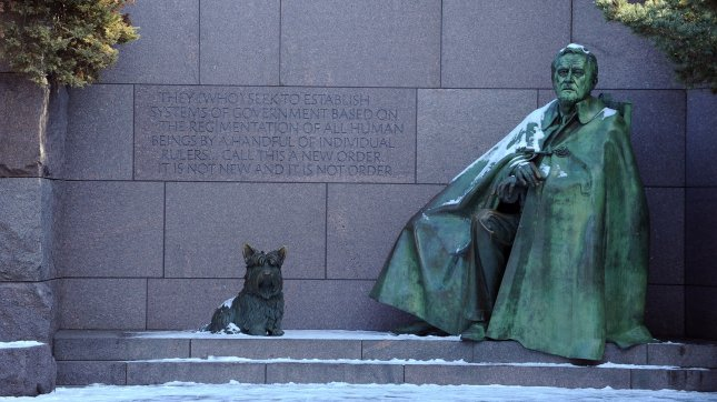 A bronze statue of President Franklin Delano Roosevelt is seen dusted with snow at his memorial along the Tidal Basin in Washington on January 13, 2011. UPI/Roger L. Wollenberg