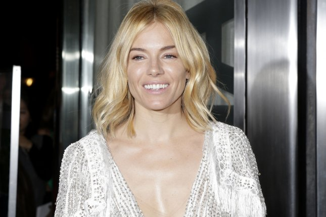Sienna Miller arrives outside at the premiere of Burnt at MoMA on October 20, 2015 in New York City. Photo by John Angelillo/UPI