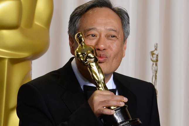 Director Ang Lee holds his Oscar for Best Achievement in Directing for Life of Pi backstage at the 85th Academy Awards in Los Angeles on February 24, 2013. File Photo by Jim Ruymen/UPI